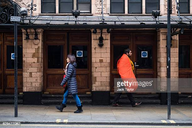 A man carrying a sleeping bag walks past the Palace Theatre in the West End on December 6 2016 in London England Homelessness charity Shelter...