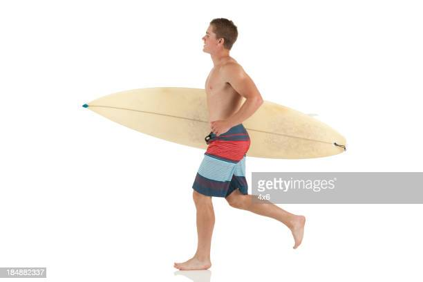 Man carrying a surfboard