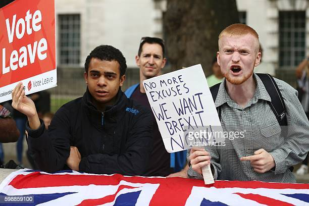 A man carrying an antiEU proBrexit placard shouts in a counter protest against proEurope marchers on a March for Europe demonstration against the...