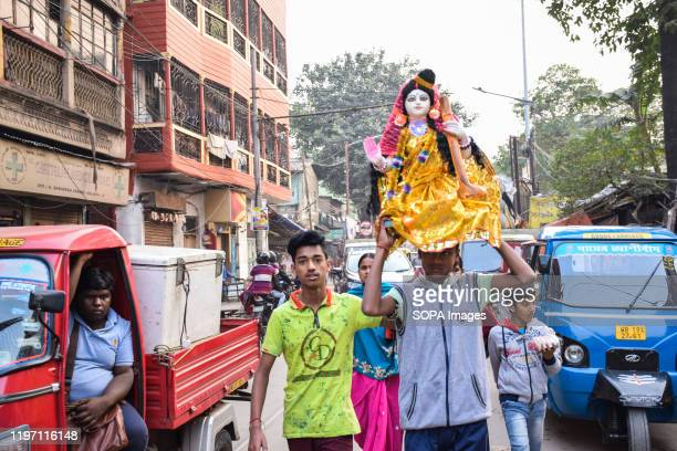 A man carrying an idol during the preparation Basant panchami is the fifth day of magha a month of the Hindu calendar which is celebrated as...