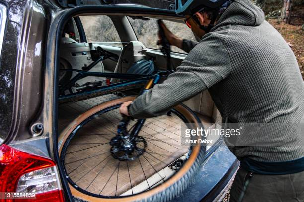 man carrying bicycle in a wagon car after practicing mountain biking in the nature. - active lifestyle stock pictures, royalty-free photos & images