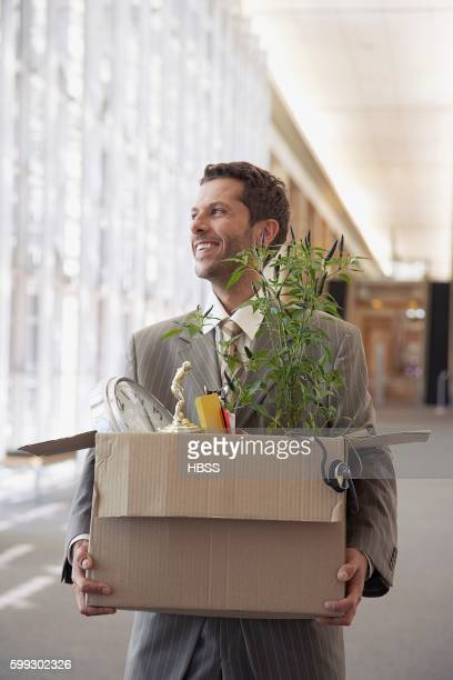 Man carrying box of belongings