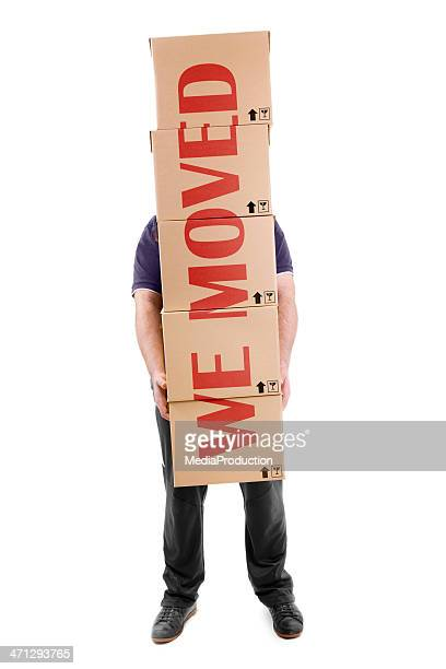Man carrying boxes with a big  sign across them