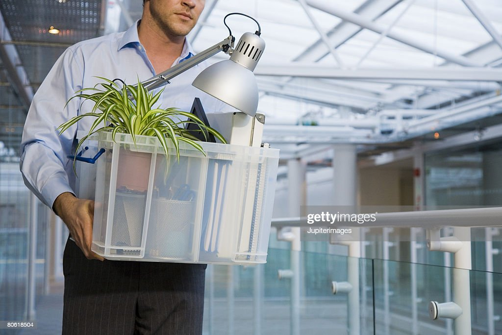 Man carrying business objects : Stock Photo