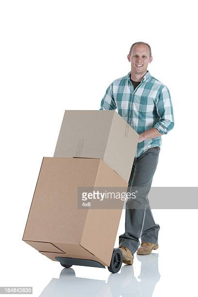 Man carrying cardboard box on a cart