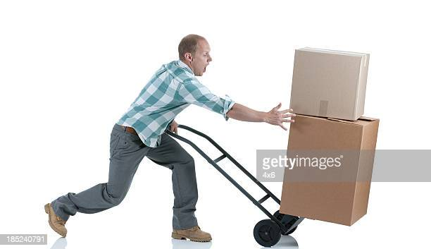 Man carrying cardboard boxes in a warehouse