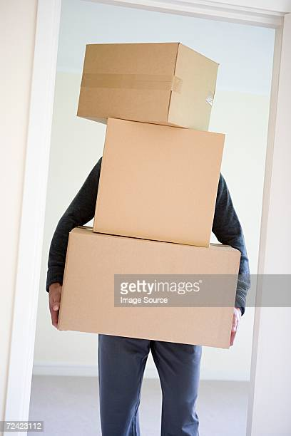 man carrying cardboard boxes - concealed carry stock photos and pictures