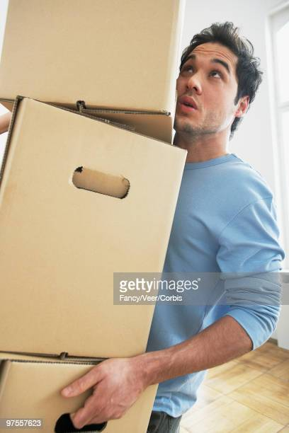 Man carrying cardboard boxes