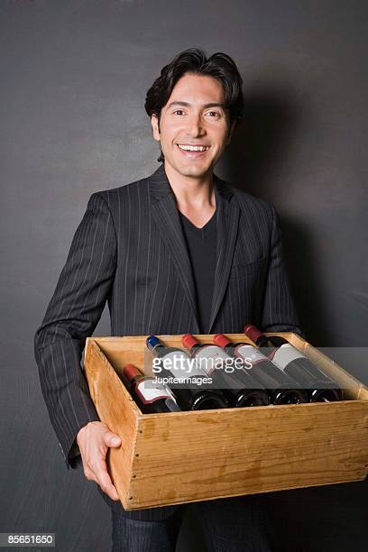 Man carrying case of wine
