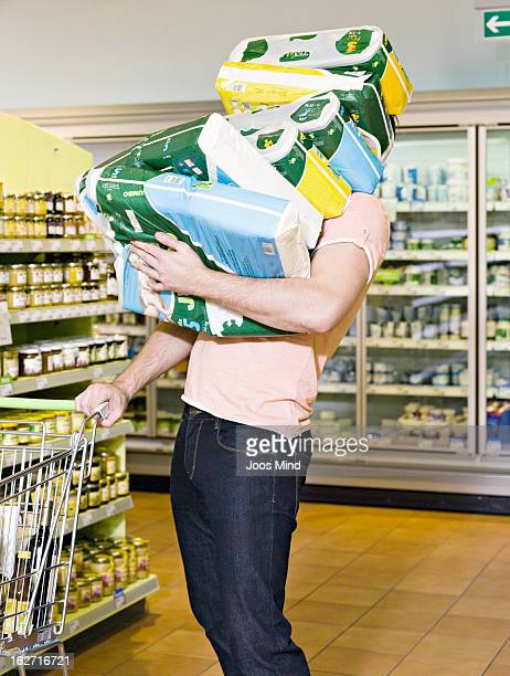 man carrying chemist`s produce in supermarket - funny toilet paper stock pictures, royalty-free photos & images