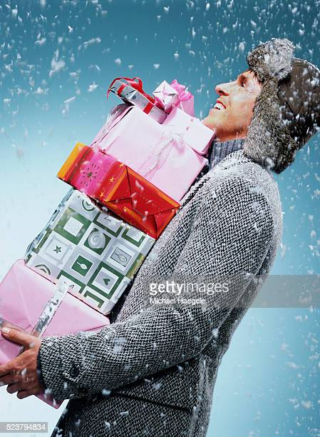 Man Carrying Christmas Presents in Snow