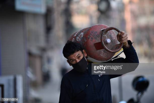 Man carrying cooking gas during lockdown as concerns about the spread of Corona Virus at Kathmandu, Nepal on Friday, April 03, 2020.