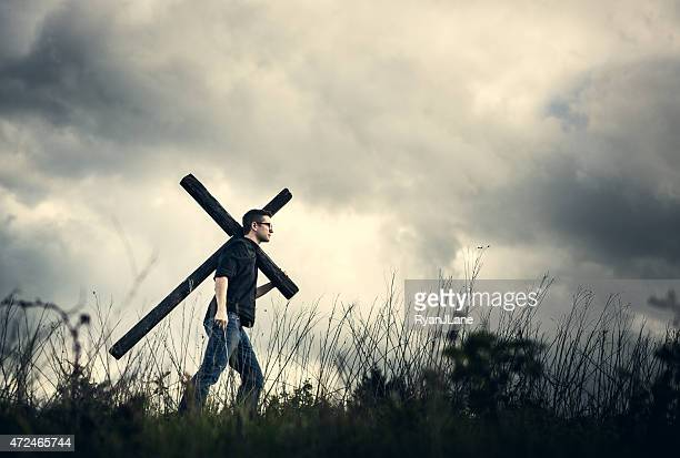 man carrying cross of christ on his shoulder - following moving activity stock pictures, royalty-free photos & images