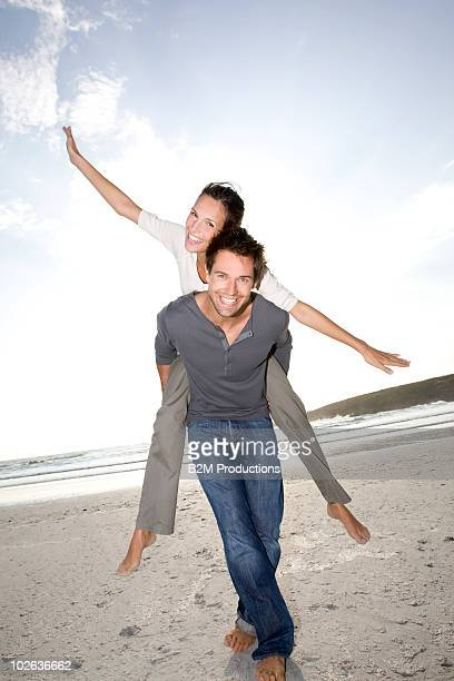 Man carrying girlfriend by the sea, Portrait