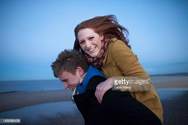 man carrying girlfriend piggyback - edinburgh scotland stock pictures, royalty-free photos & images