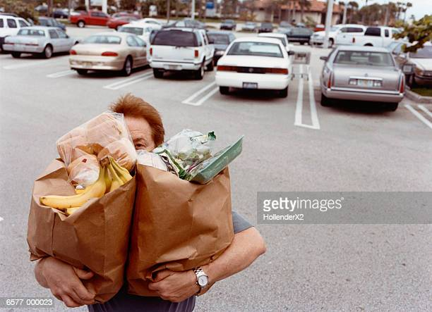 man carrying grocery bags - full stock pictures, royalty-free photos & images