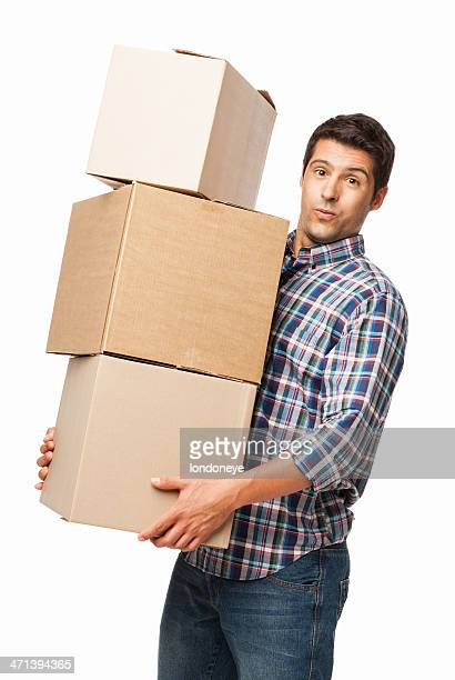 Man Carrying Heavy Stack Of Cardboard Boxes - Isolated