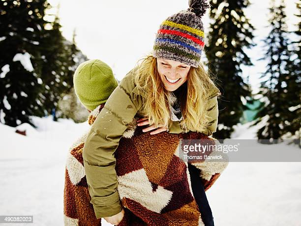 man carrying laughing wife over shoulder - real wife sharing stock photos and pictures