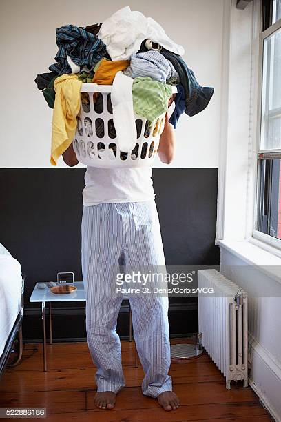 Man carrying laundry basket