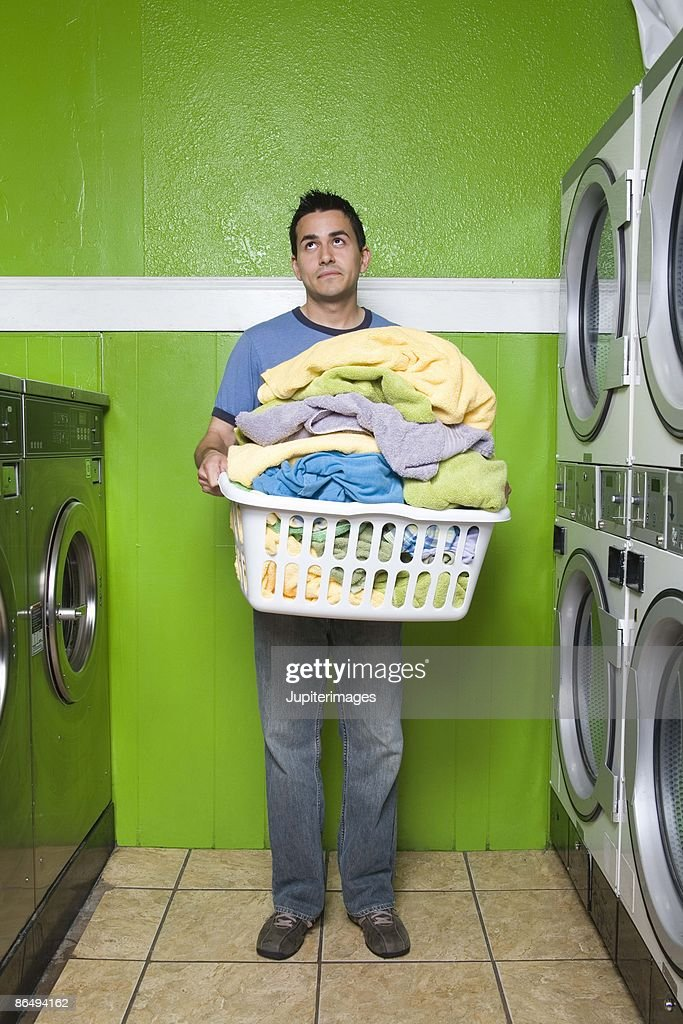 Man carrying laundry basket : Stock Photo