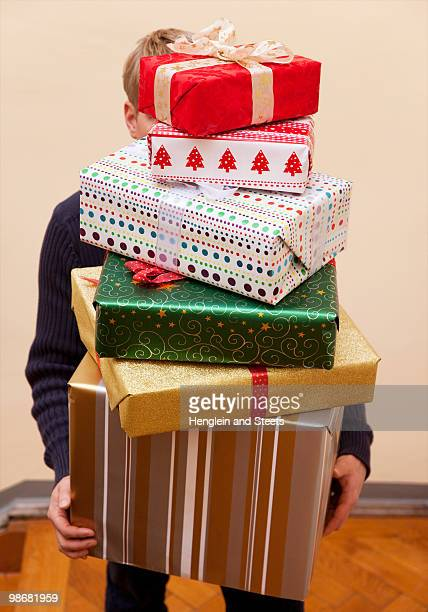 man carrying pile of  presents