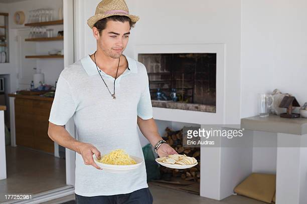 Man carrying plates of food