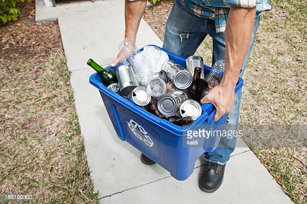 Man carrying recycle bin
