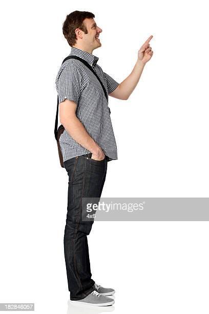 homem carregando bolsa de ombro e sorrindo - gesticulando - fotografias e filmes do acervo