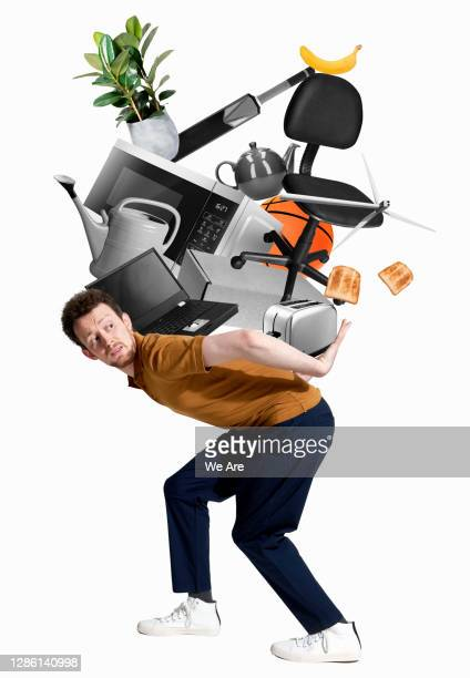 man carrying stack of household items - heap stock pictures, royalty-free photos & images