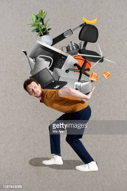 man carrying stack of household items - picking up stock pictures, royalty-free photos & images