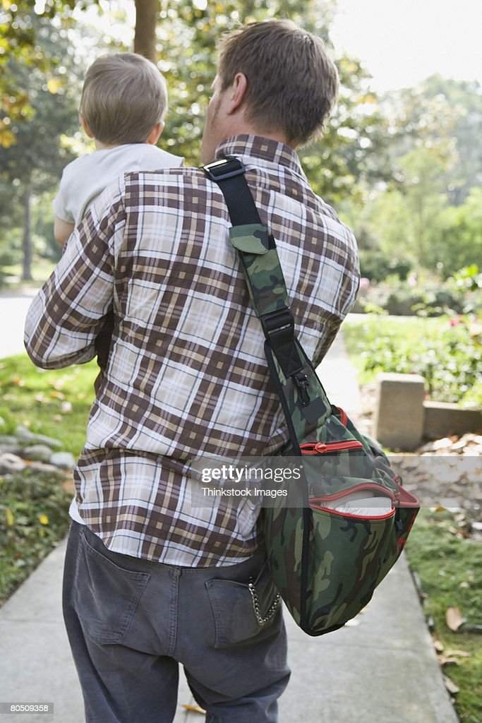 Man carrying toddler : Stock Photo