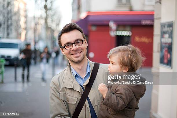 Man carrying toddler son, portrait