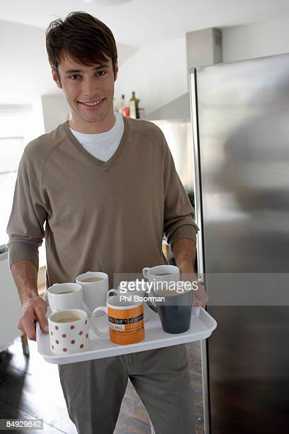 Man carrying tray of drinks