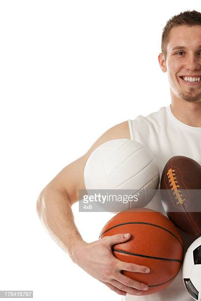 man carrying various balls - sports equipment stock pictures, royalty-free photos & images