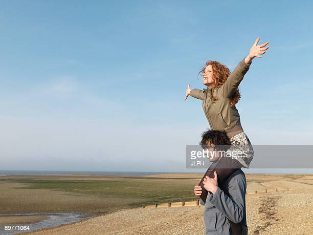 man carrying woman on shoulders - adults only stock pictures, royalty-free photos & images