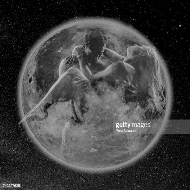 Man carrying woman within transparent planet earth