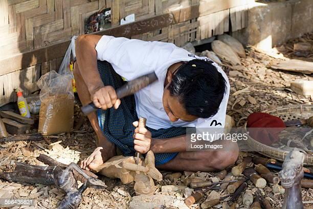 A man carving Burmese marionettes in Mandalay in Myanmar