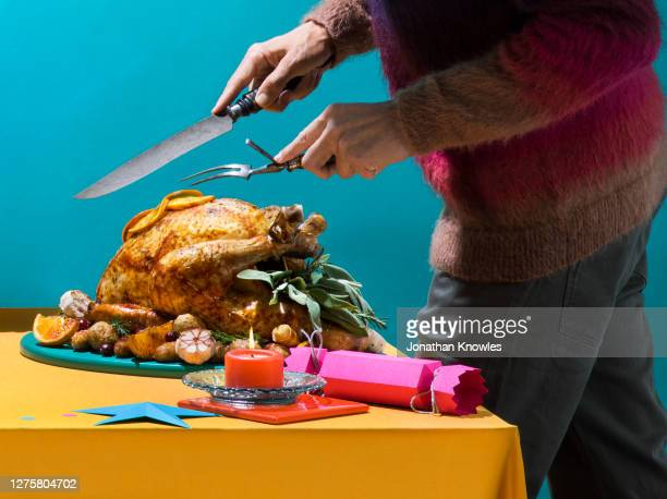 man carving christmas turkey - table stock pictures, royalty-free photos & images