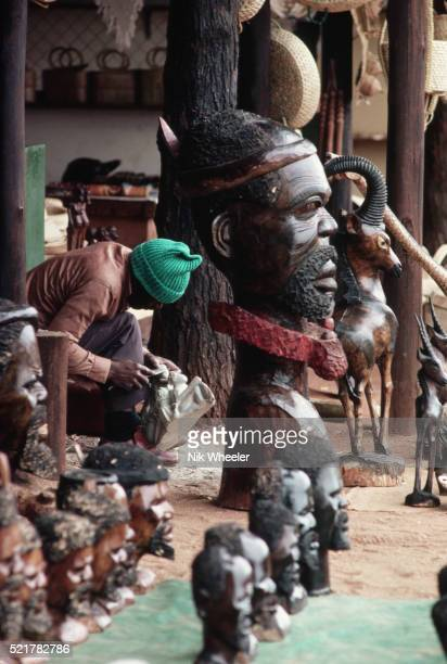 man carving soapstone sculpture - soapstone stock pictures, royalty-free photos & images