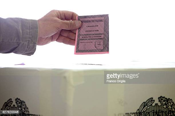 Man casts her ballot for a referendum on constitutional reforms at a polling station on December 4, 2016 in Rome, Italy. The result of the government...