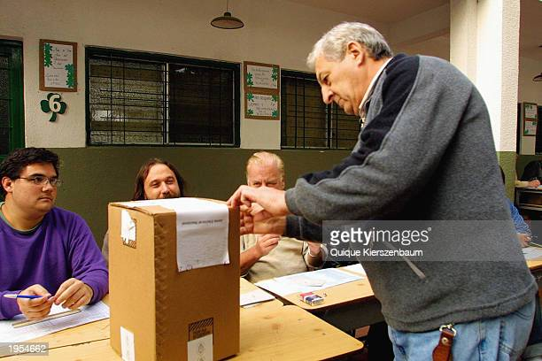 A man casts his ballot at a polling station April 27 2003 in downtown Buenos Aires Argentina Exit polls showed little in the way of a clear winner In...