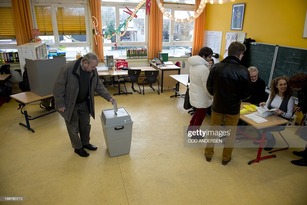 A man casts his ballot at a polling station at the Friedrich-Dierks Schule in Isernhagen, Germany on January 20, 2013 on polling day of the local elections in the central German state of Lower Saxony.