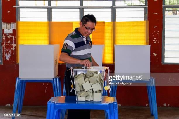 A man casts his ballot at a polling station during the byelection in Port Dickson on October 13 2018 The Port Dickson seat was vacated to enable...