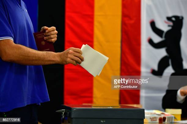 Man casts his ballot at a polling station in Berlin during general elections on September 24, 2017. Polls opened in Germany in a general election...