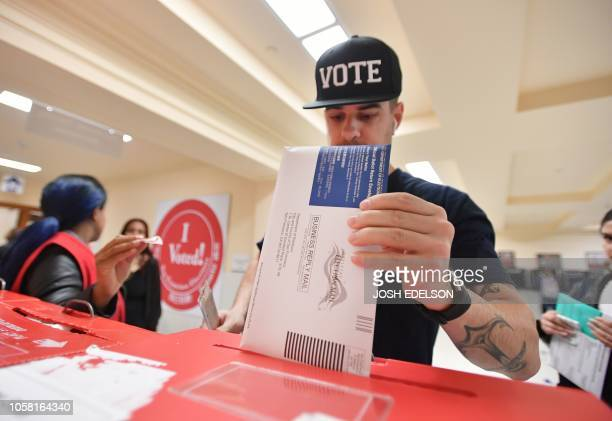Man casts his ballot at City Hall in San Francisco, California on November 6, 2018. - Americans started voting Tuesday in critical midterm elections...