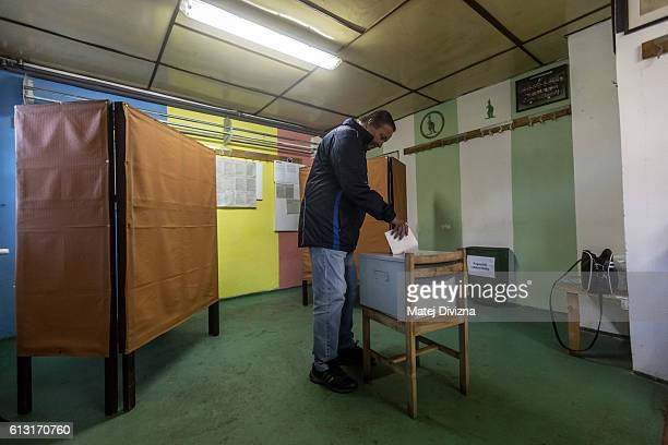 A man casts his ballot at dressing room of local football club during the first day of the Czech regional and senate elections on October 7 2016 in...