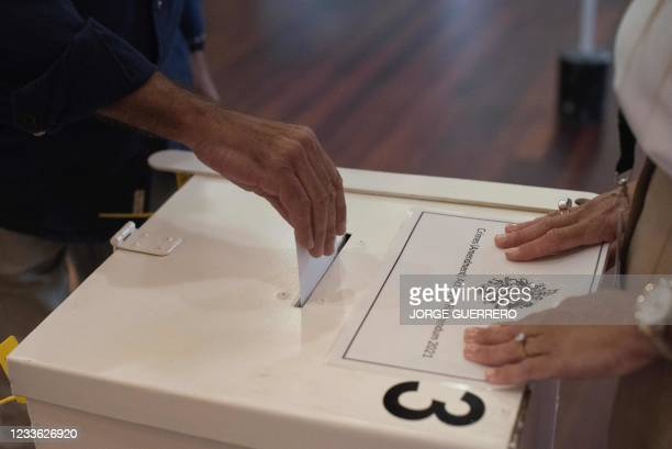 Man casts his ballot during a referendum to ease an abortion law at a polling station in Gibraltar, on June 24, 2021. - Gibraltar began voting on...