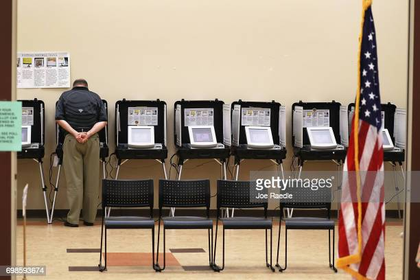 A man casts his ballot during a special election in Georgia's 6th Congressional District special election at North Fulton Government Service Center...