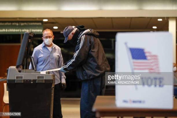 A man casts his ballot in a Democratic presidential primary election at the Journey Church in Kenosha Wisconsin on April 7 2020 The Wisconsin Supreme...