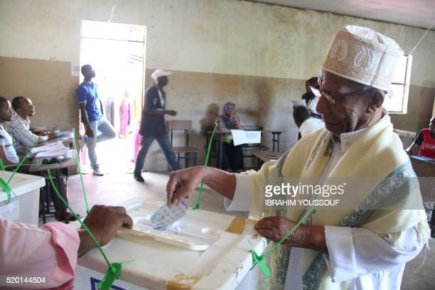 A man casts his ballot in Moroni on April 10 2016 during the second round of Presidential elections in Comoros Voters head to the polls in the Indian...